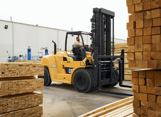 Operator Driving a Cat Class 5 Diesel Forklift to Transport Material