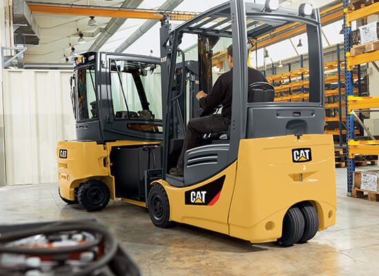 Cat Electric Forklift Loading a Battery into Another Forklift
