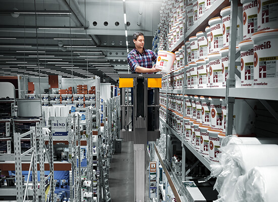 Worker Picking a Container off a Shelf from a EKM 202