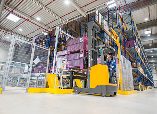 Jungheinrich ETV Series High Reach Truck Lifting Merchcandise in a Warehouse